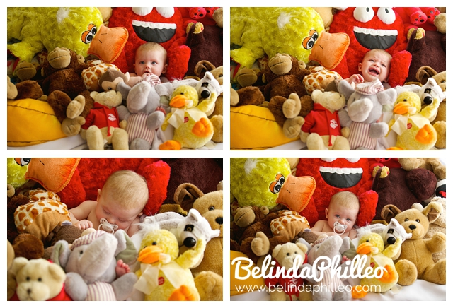 baby surrounded by stuffed animals