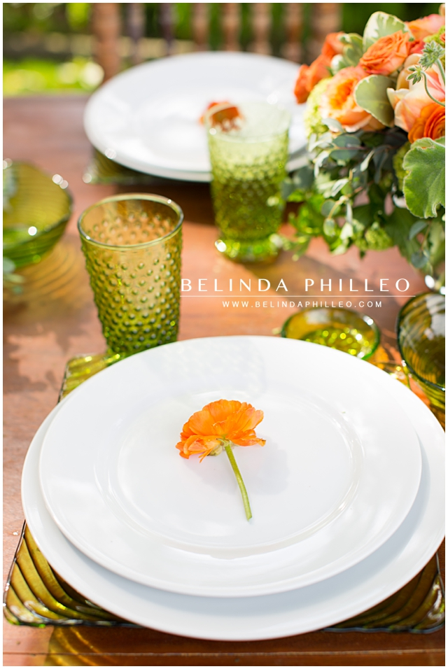 Orange Rose place settings at an outdoor reception