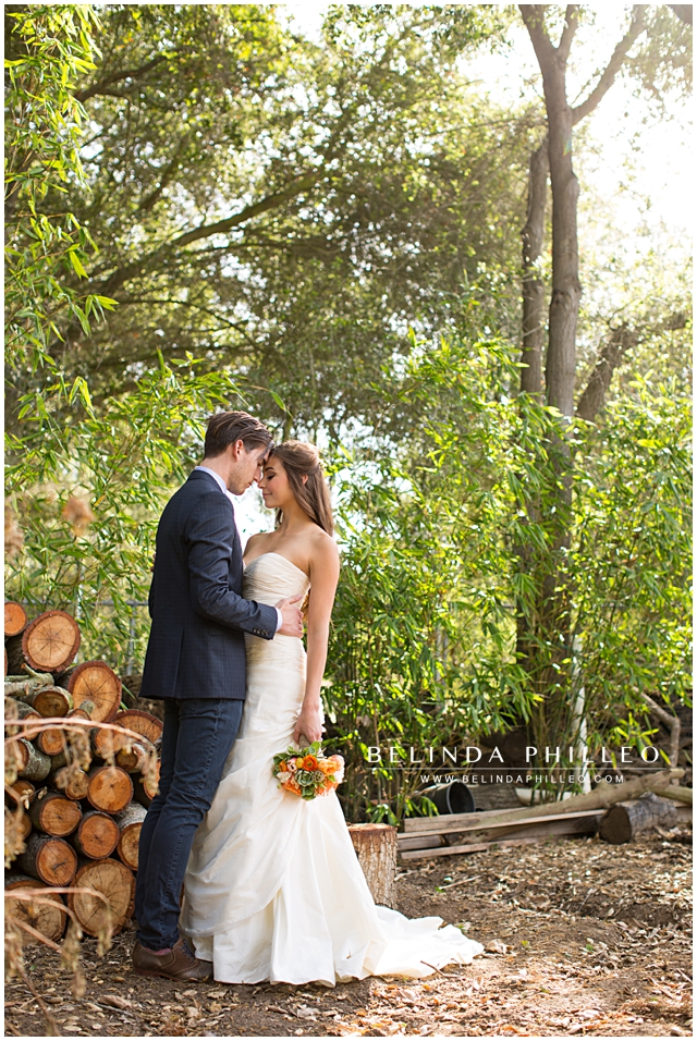 rustic wedding photography. bride and groom sharing a moment near a woodpile