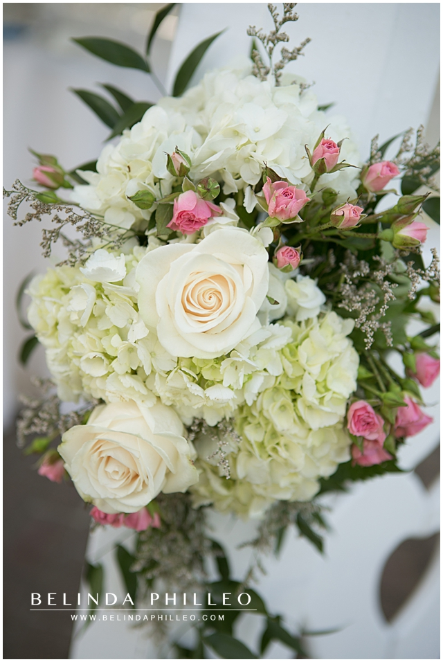 Ceremony Florals with white roses, pink baby roses and hydrangeas created by Victoria's Garden Anaheim