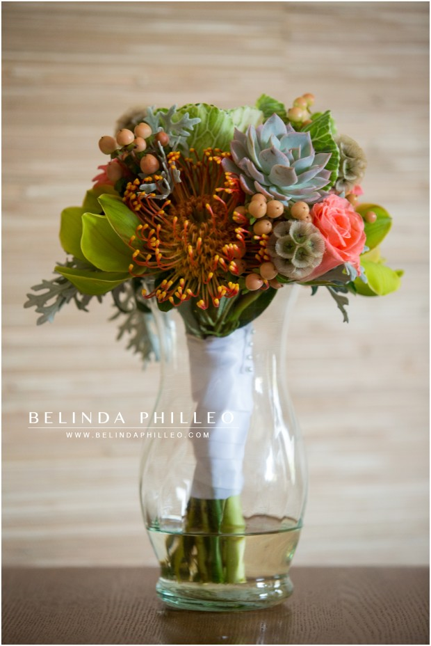 bridal bouquet of succulents, berries and roses