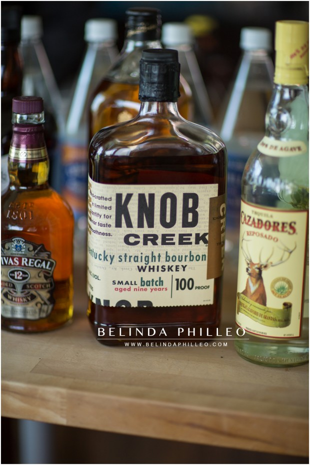 a groom and his groomsmen take shots of knob creek whiskey