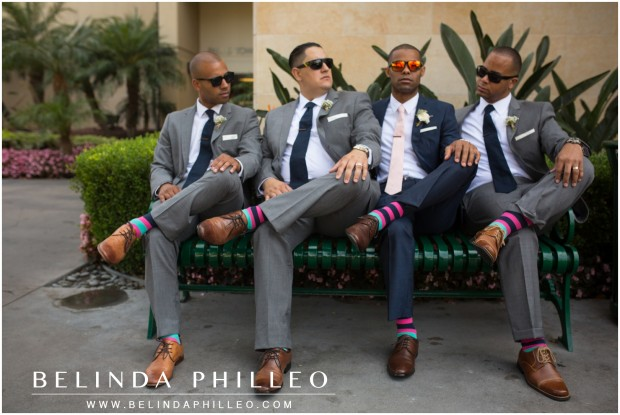 groomsmen show off their colorful socks at the Anaheim Marriott