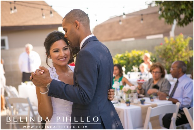 Bride and groom dance at their intimate backyard wedding reception, Buena Park, CA