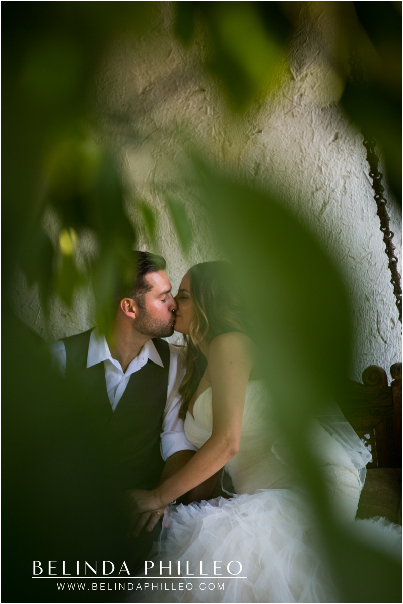 Bride and groom share a private kiss at their Casa Cody Inn Wedding in Palm Springs, CA