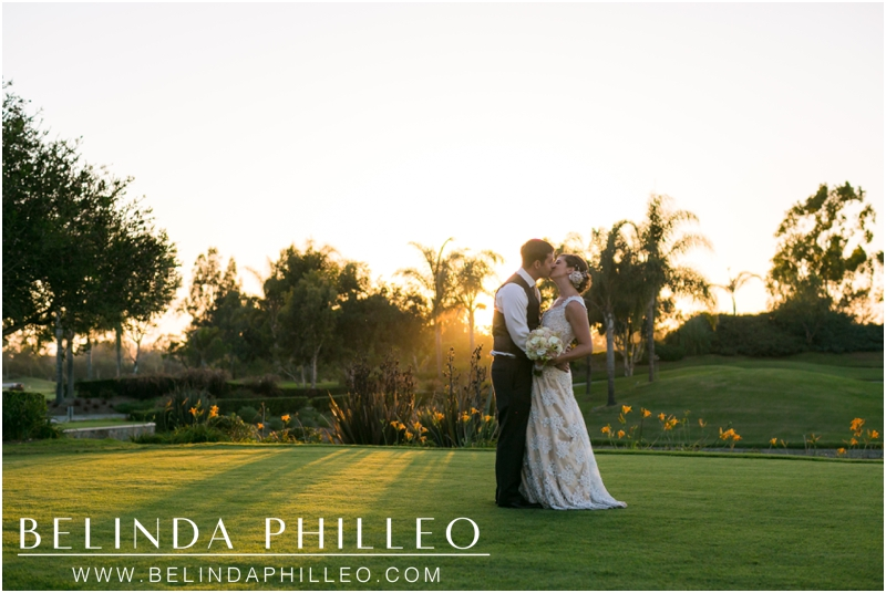 Bride and groom share a kiss during a romantic sunset at Old Ranch Country Club, Seal Beach, CA