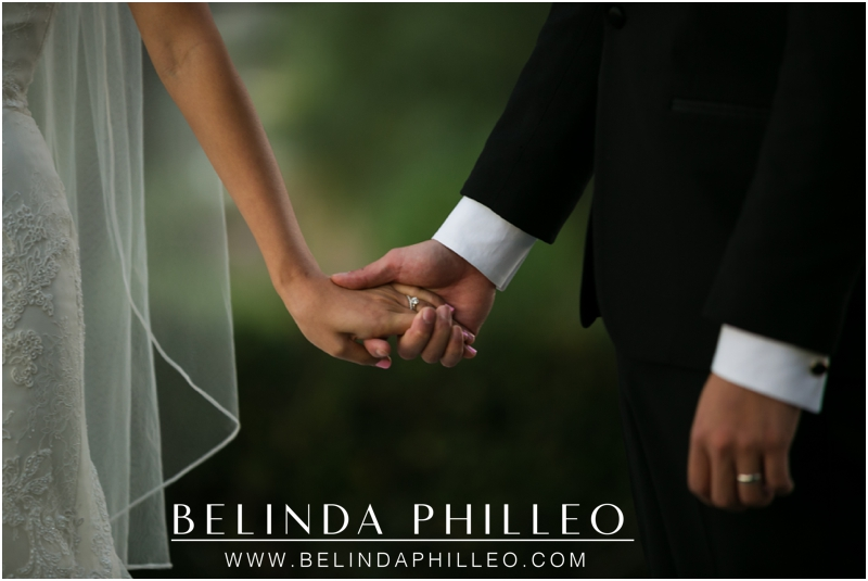 Bride and groom hold hands on their wedding day at Summit House Restaurant, Fullerton, CA