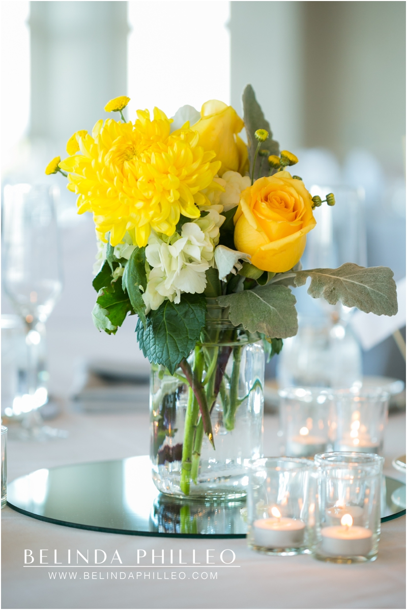 Yellow floral centerpieces at Summit House Restaurant Wedding, Fullerton, CA