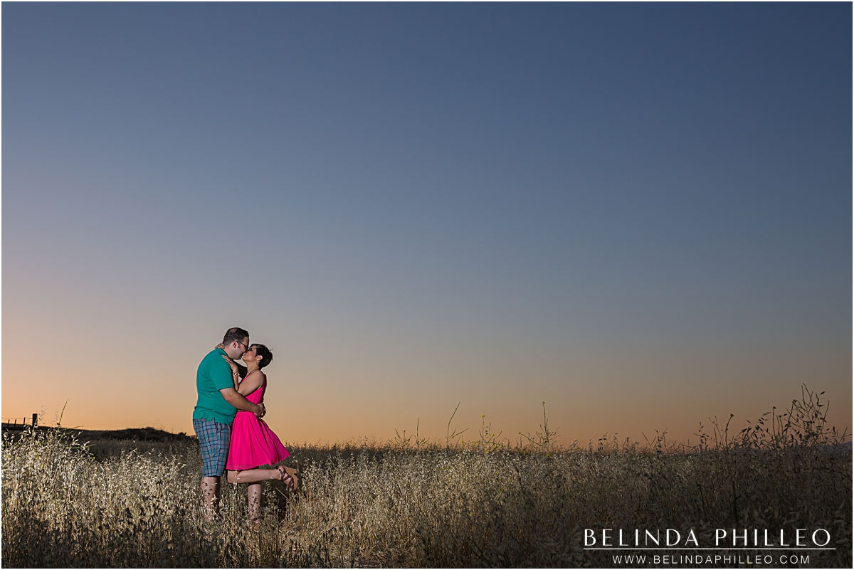 Engaged couple kissing at sunset in Irvine, CA