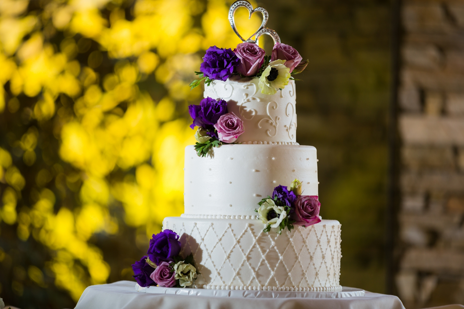 Purple and white wedding cake at Dove Canyon Country Club, Dove Canyon, CA