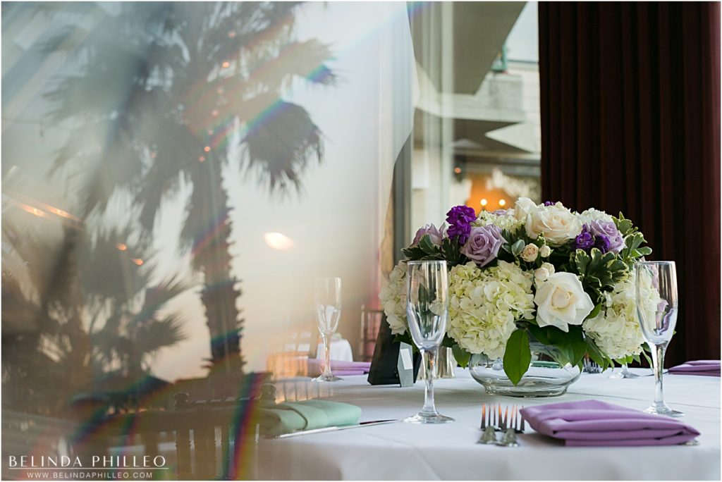 white and purple floral centerpieces at the Reef Restaurant, Long Beach, CA