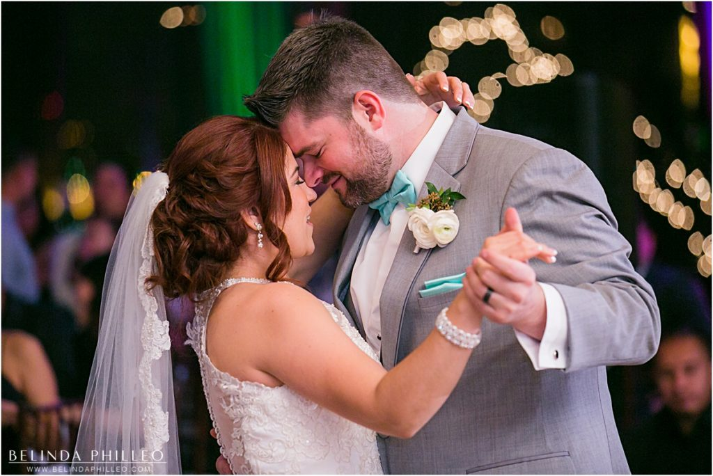 Bride and groom share their first dance at Reef Restaurant wedding reception in Long Beach, CA