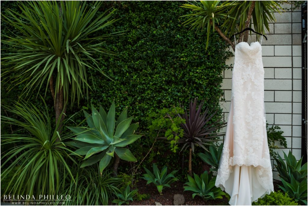 Wedding gown hangs among the greenery at Smog Shoppe Los Angeles. Photo by Belinda Philleo