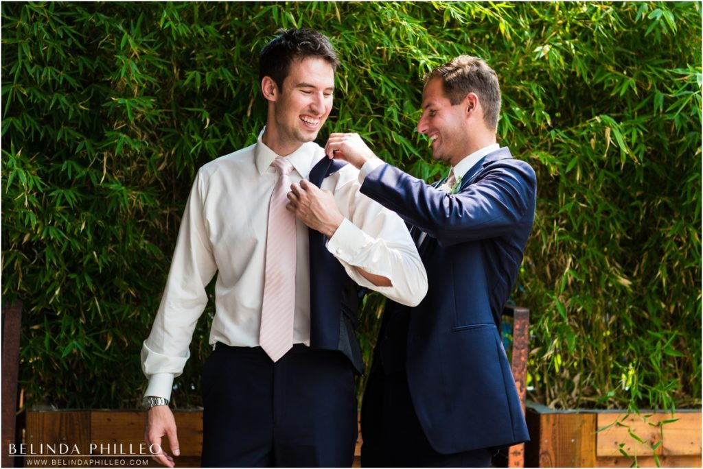 Best man helps groom get ready at Smog Shoppe Los Angeles. Photo by Belinda Philleo