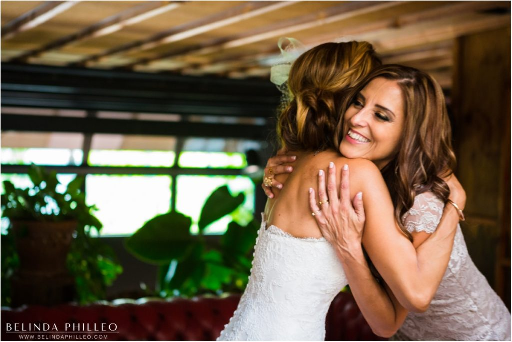 Bride and Maid of Honor share an emotional embrace before the ceremony at Smog Shoppe Los Angeles. Photo by Belinda Philleo