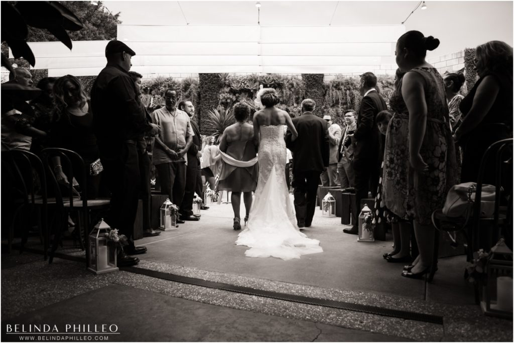 Bride walks down the aisle at Los Angeles Smog Shoppe wedding. Photo by Belinda Philleo