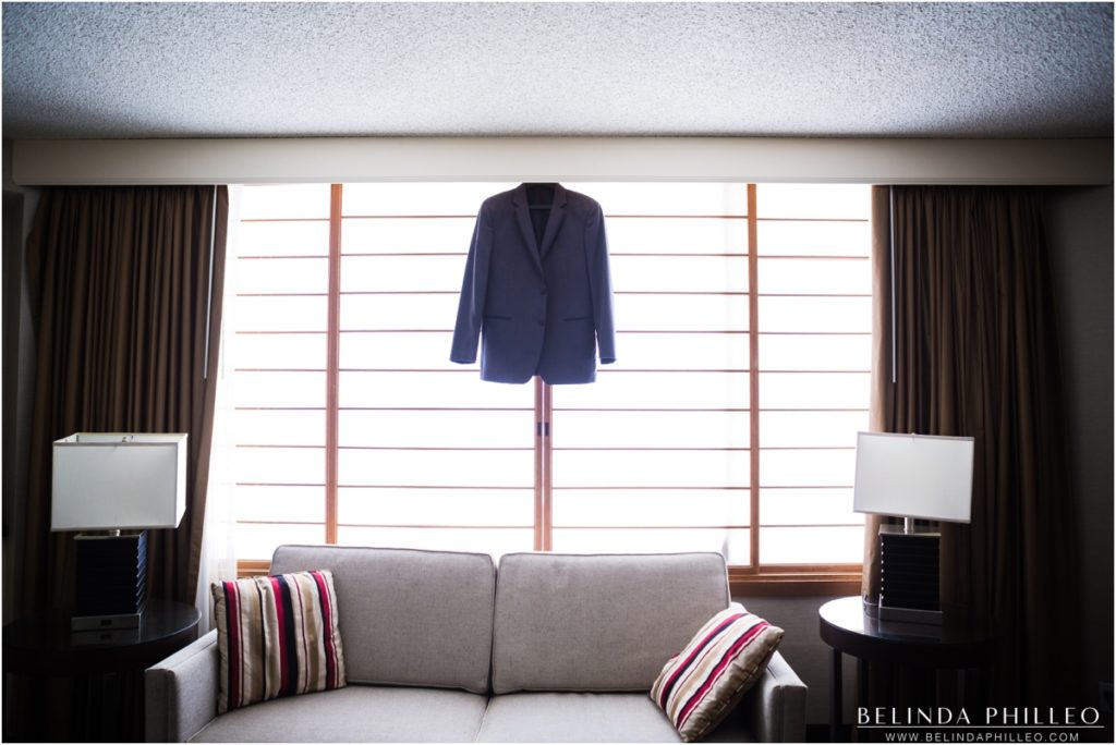 Groom's suit hanging in Double Tree Los Angeles