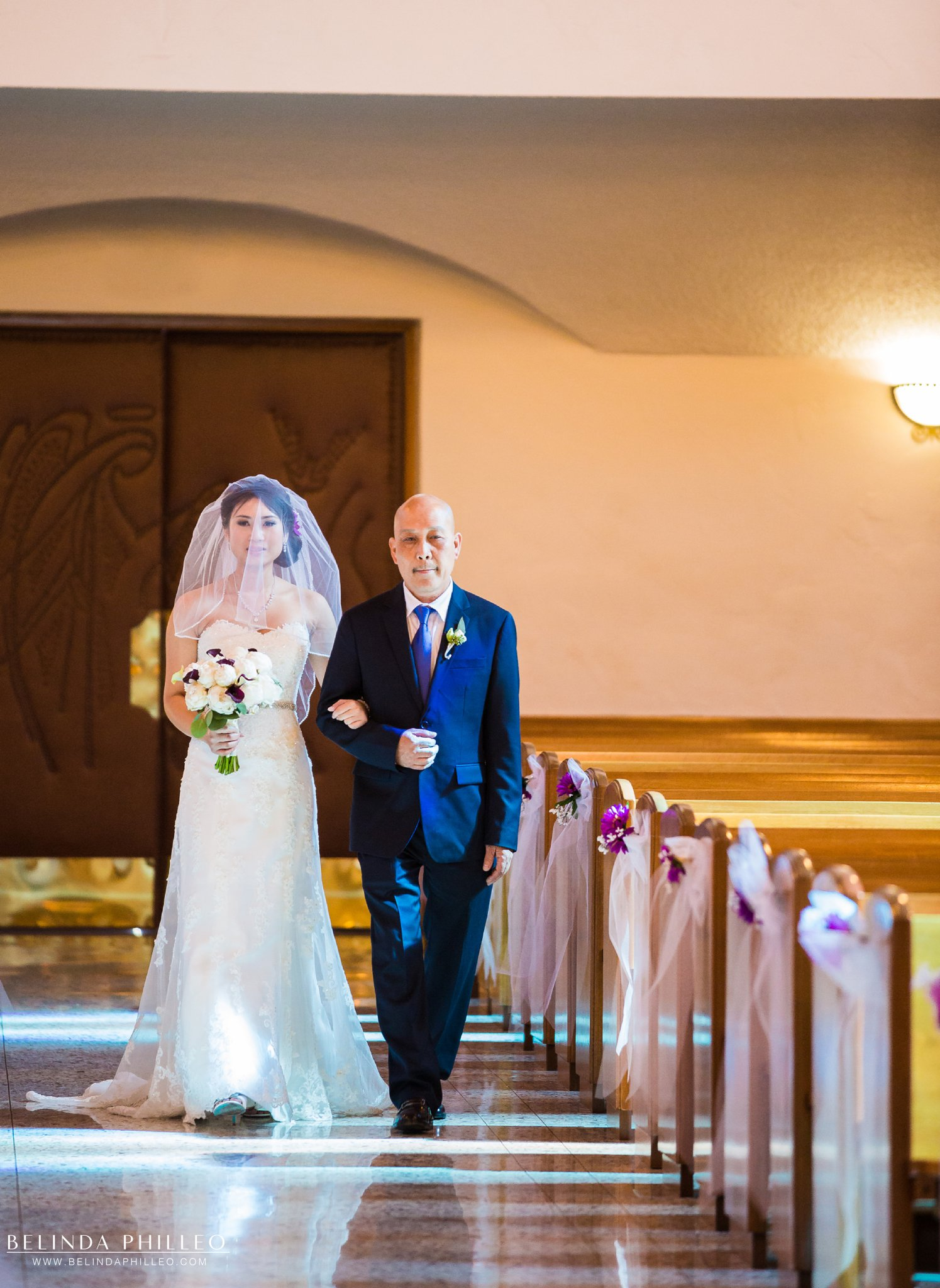 Bride is escorted down the aisle by her father at the San Gabriel Mission & church