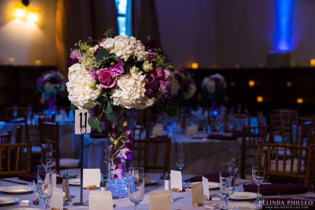 Purple Rose and white Hydrangea centerpieces at Redondo Beach Historic Library Wedding. Photo by Belinda Philleo