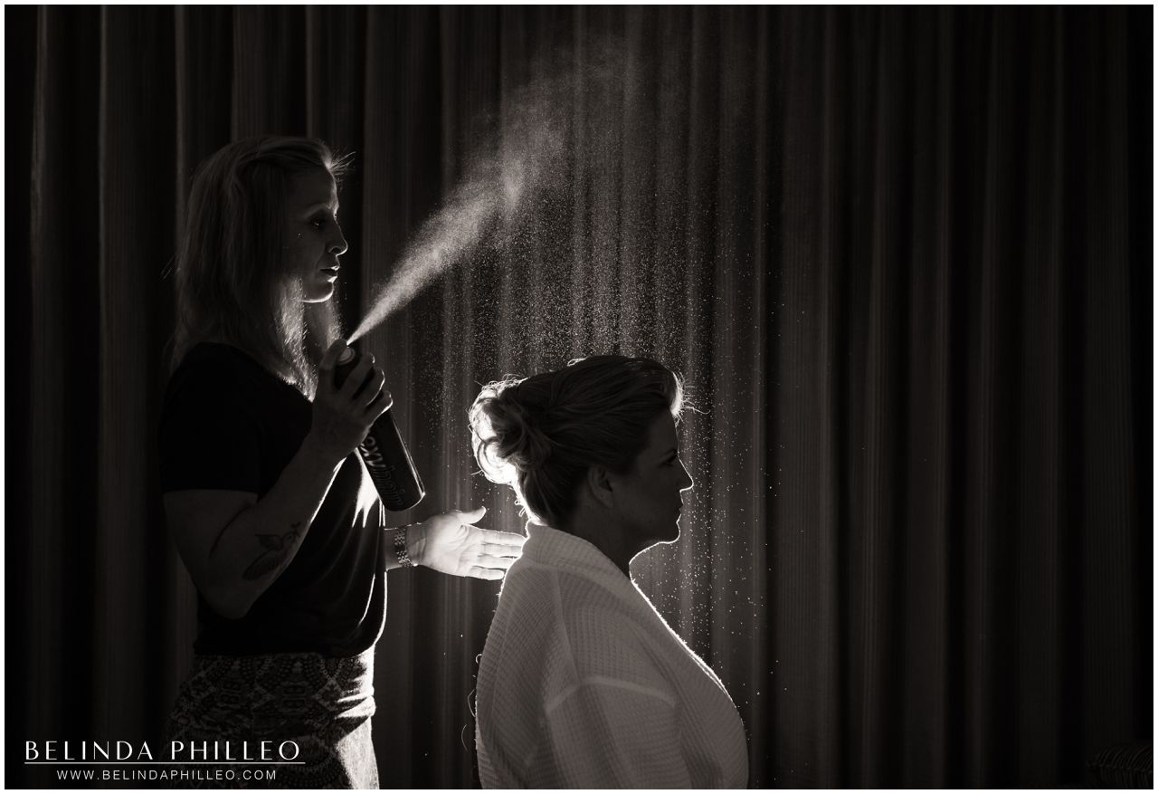 Bride gets her hair done before ceremony