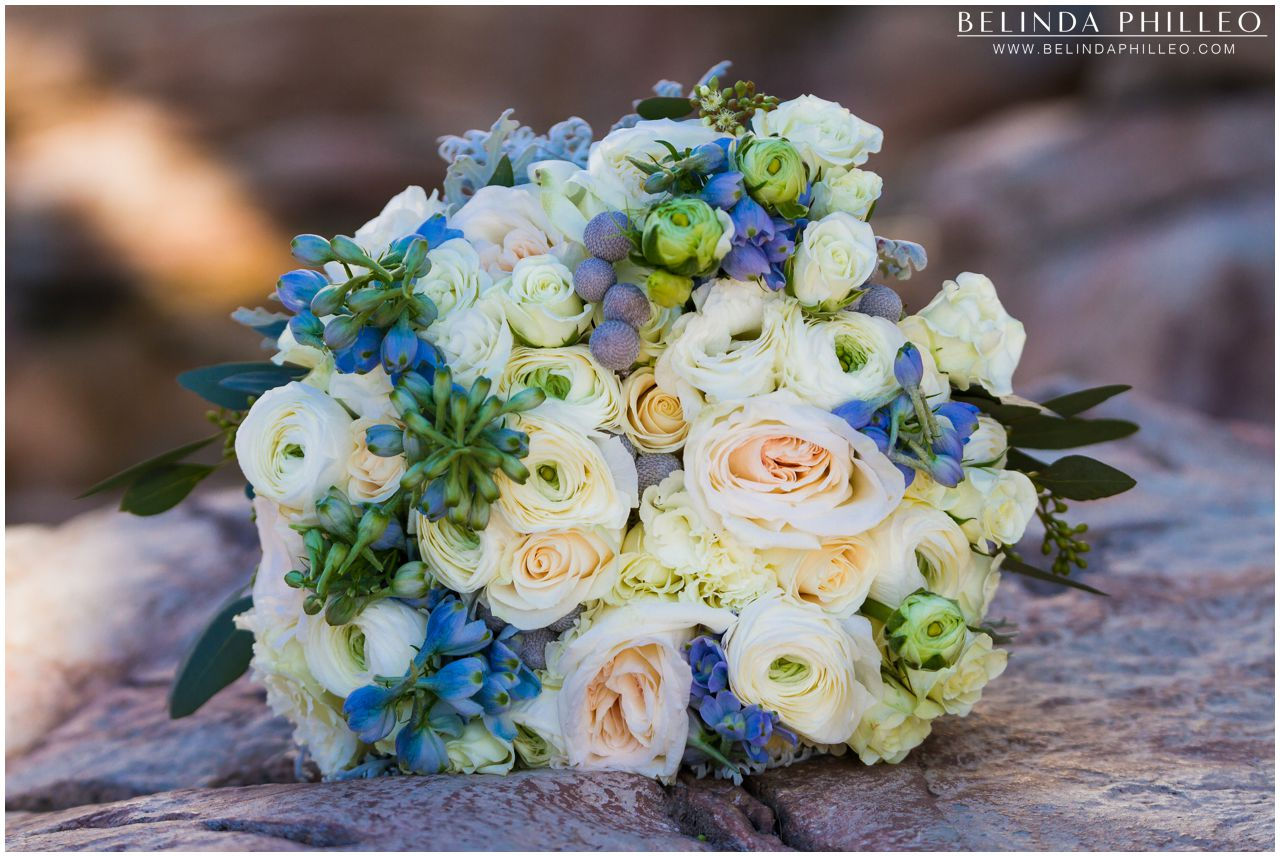 Blue and white bridal bouquet created by Flowers by Cina