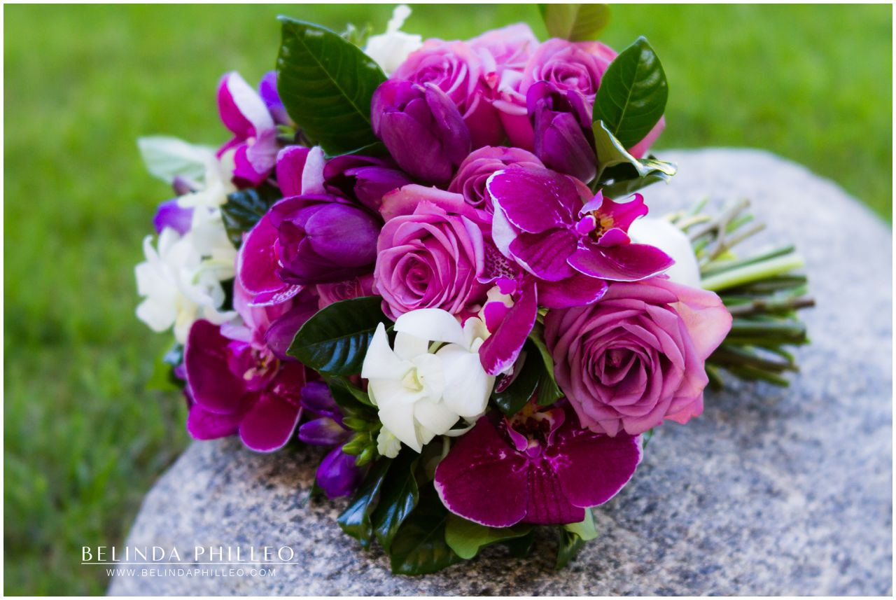 Bridal bouquet of purple roses and orchids created by Violette's Flowers. Photo by Belinda Philleo