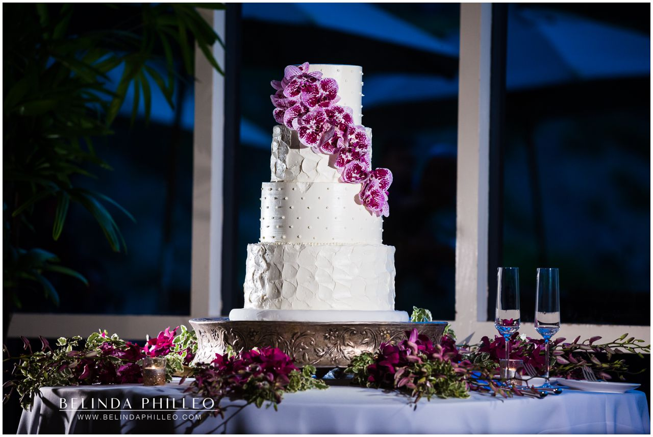 Purple orchids decorate a white wedding cake by Simply Irresistible Cakes. Photo by Belinda Philleo
